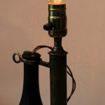 "Webziks collaborates modern technology with pieces of days gone by with this funky antique telephone light 17"" (h)."